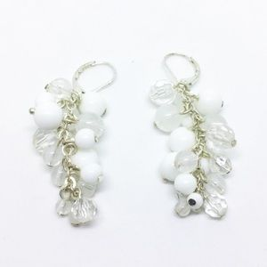 Silver and white dangle earrings with lever backs